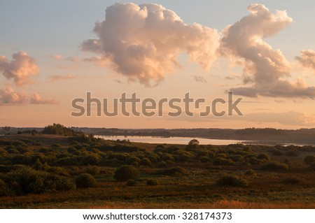 view to river with reflections and blue cloudy sky - stock photo