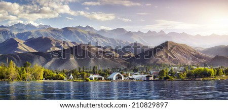 View to Ruh Ordo cultural complex near Issyk Kul lake at mountains background in Cholpon Ata, Kyrgyzstan - stock photo