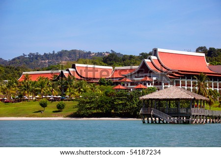 View to sea and houses of tropical resort. - stock photo