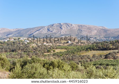 View to Sivas. Panorama landscape from south-central Crete. In the background the Asterrusia mountains and the village Listaros. In the foothills the typical greek landscape with olive groves - stock photo