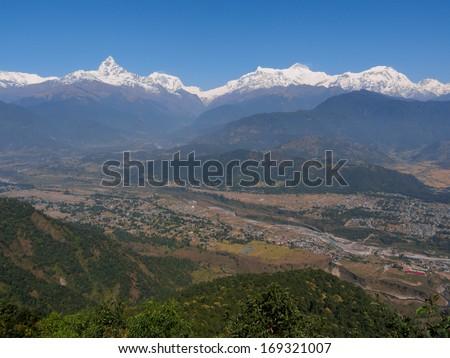 View to the Annapurna Himalayan range from the Sarangkot viewpoint above Pokhara, Nepal - stock photo