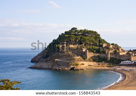 View to the beach and medieval castle in Tossa de Mar, Catalonia, Spain, Costa Brava - stock photo