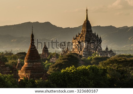 View to the Gawdawpalin Temple in the Bagan Area in front of the surrounding hills at late afternoon - stock photo