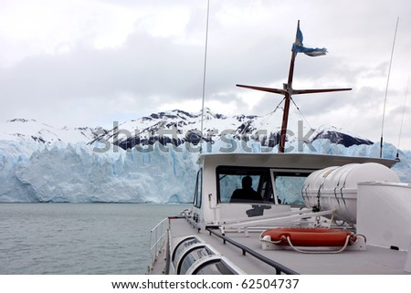 View to the glacier with nearby mountain from a boat - stock photo