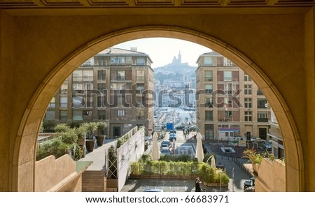 View to the old port of Marseilles through the arch of town hall - stock photo