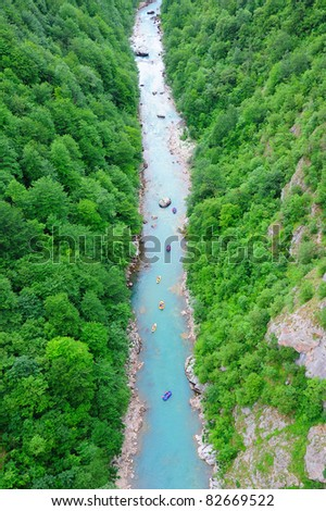 View to the river Tara and rafters in the canyon (Montenegro, Europe) - stock photo