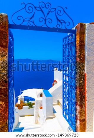 View to the sea and Volcano through a door, from Fira the capital of Santorini island in Greece - stock photo
