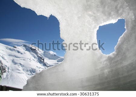 View to the top of the Mont Blanc from ice grotto - stock photo