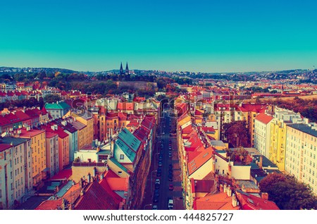 View to the Vysegrad in Prague, Czech Republic at autumn with cathedral and red roofs, travel seasonal vintage hipster background - stock photo
