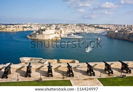 View to Vittoriosa Harbor and medieval cannons battery from Valetta wall, Malta - stock photo