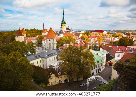 View top on historic centre of Tallinn in the Estonia. Red roofs of the old houses of the European city Tallinn. The ancient architecture. Roof with wings. - stock photo