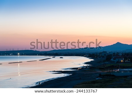 View towards the city of Larnaca in southern Cyprus during the evening twilight, with the Troodos Mountains on the horizon. Cyprus is an island in the Mediterranean Sea. - stock photo
