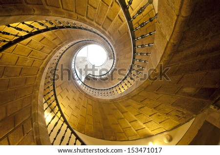 View up a dramatic triple spiral staircase. - stock photo