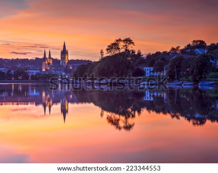 View up river at sunset from Malpas with Truro Cathedral in the background - stock photo