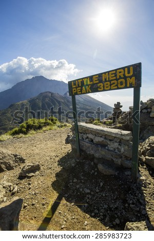 Views from Little Meru to Mount Meru, near Arusha in Tanzania. Africa. Mt Meru is located 60 kilometres west of Mount Kilimanjaro. - stock photo