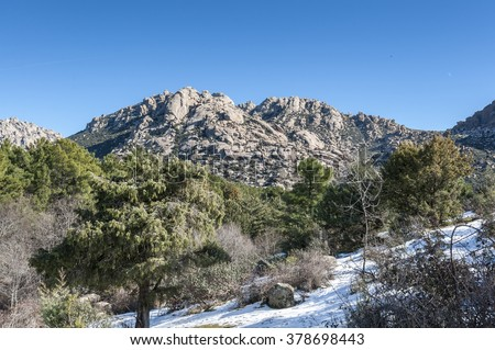 Views of La Pedriza from Canto Cochino, in Guadarrama Mountains National Park, Madrid, Spain. Pena Sirio Peak can be seen in the background - stock photo