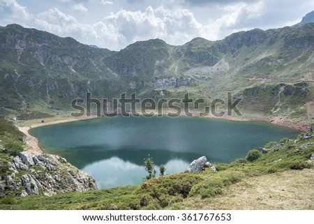 Views of Lago de la Cueva (Lake of the Cave) in Saliencia Valley,Somiedo Nature Reserve. It is located in the central area of the Cantabrian Mountains in the Principality of Asturias in northern Spain - stock photo
