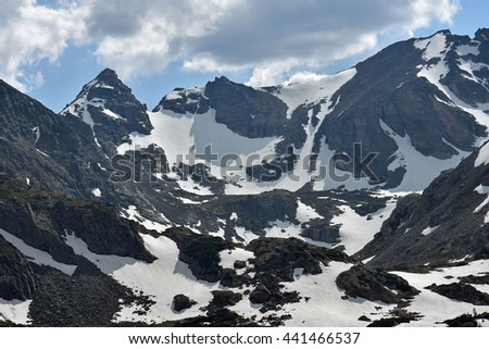 views of navajo, apache, and shoshoni peaks from lake isabelle in the indian peaks wilderness area, colorado - stock photo