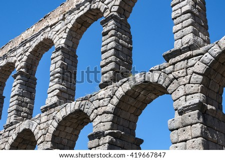Views of the Aqueduct of Segovia, Spain. It is a roman aqueduct and the date of construction cannot be definitively determined - stock photo