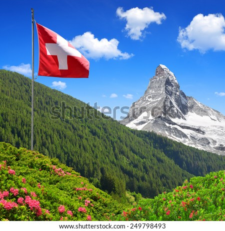 Views of the Matterhorn with Swiss flag - Swiss Alps  - stock photo