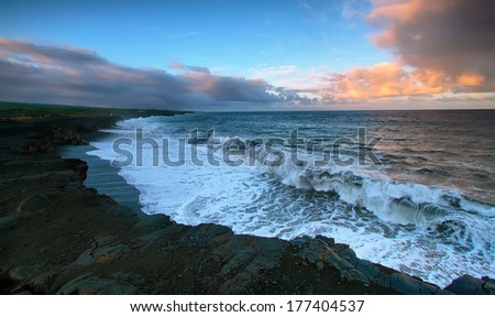 Views of the sea and black lava rocks of recent eruptions of Kilauea from Kalapana for sunset, Puna district, Big island, Hawaii - stock photo