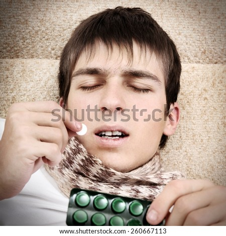 Vignetting Photo of Sick Teenager take a Pill at the Home - stock photo