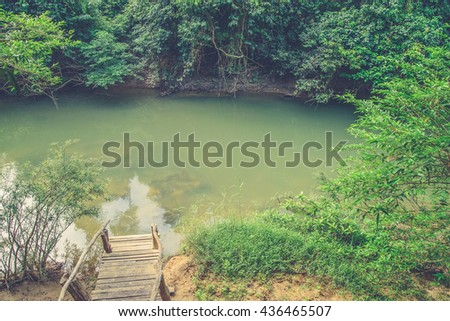 Viiew of Wooden stairs and streams. (Vintage filter effect used) - stock photo