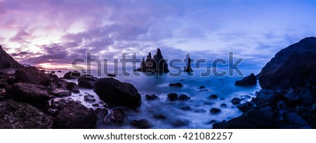 Vik Rock formation at Reynisfjara beach in Iceland - stock photo