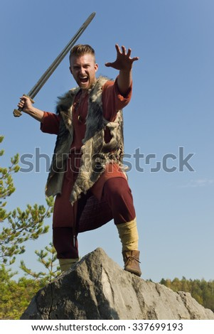 Viking attacking with a sword in the mountains