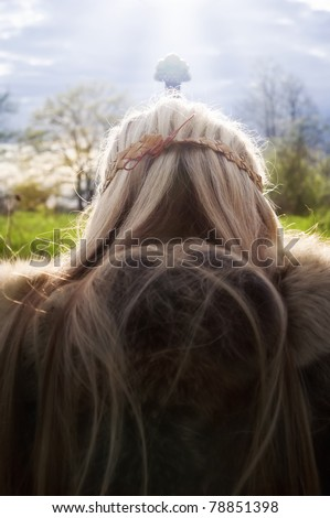 Viking girl warrior with the sword on a sky backround - stock photo