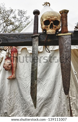 Viking tent with swords and body parts in the Medieval Castle Festival - stock photo