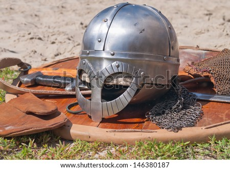 Viking weaponry. Sword, shield and helmet at a historical reenactment festival held in Abalak, Siberia. Russia. - stock photo