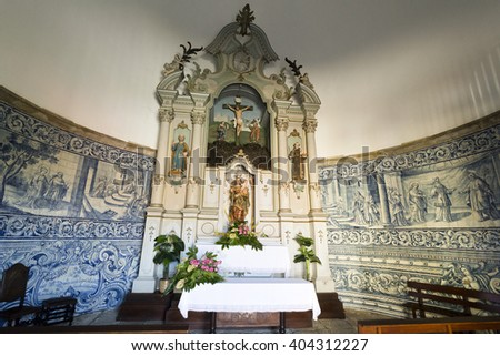 VILA DO CONDE, PORTUGAL - September 20, 2015: View of the chapel rococo style altarpiece with a statue of Our Lady holding the Child Jesus on September 20, 2015 in Vila do Conde, Portugal - stock photo