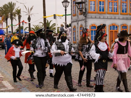 VILA REAL SANTO ANTONIO, PORTUGAL - FEBRUARY 14: Parade participants dance during the Carnival Parade February 14, 2010 in Vila Real Santo Antonio , Algarve,Portugal. - stock photo