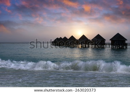 Villa on piles on water at the time sunset. Maldives.  - stock photo