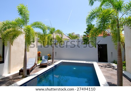 Villa with swimming pool and relaxation bed - stock photo