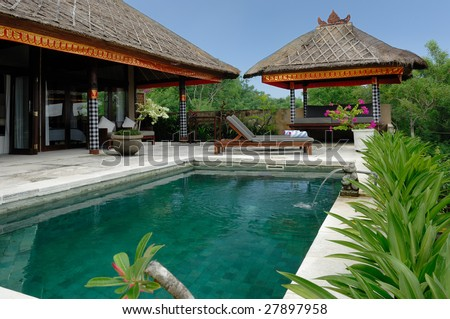 Villa with swimming pool and relaxation bed. - stock photo