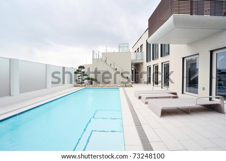Villa with swimming pool and relaxation bed-1 - stock photo