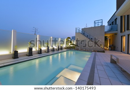 Villa with swimming pool night view-1 - stock photo