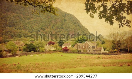 Village in Lake District, Cumbria. UK.  Photo in retro style. Added paper texture. - stock photo