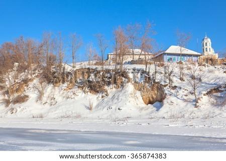 village in the wintertime - stock photo