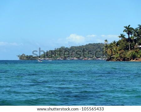 Village of Old Bank at the horizon on the island of Bastimentos, archipelago of Bocas del Toro, Caribbean sea, Panama - stock photo