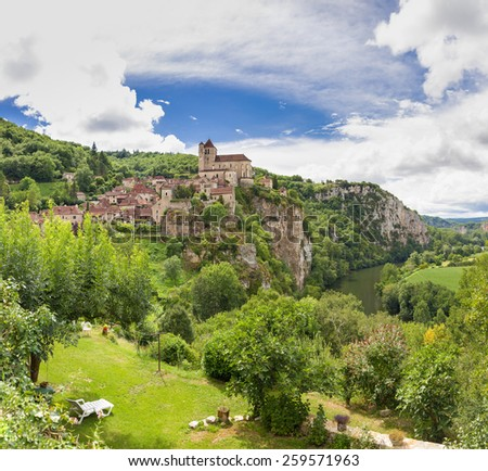 Village of Saint Circ Lapopie in France against a blue sky - stock photo