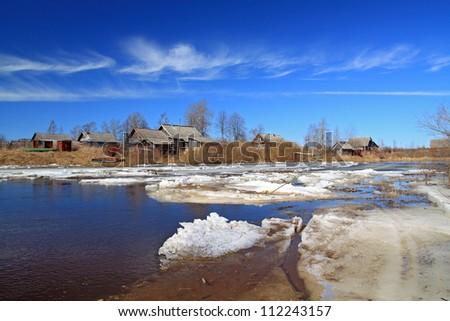 village on coast autumn river - stock photo