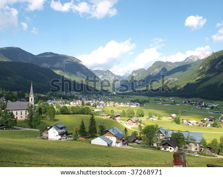 Village on the meadow by Alps. Shoot in Gosau , Austria.   - stock photo