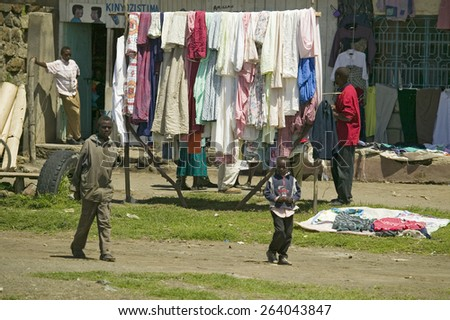 Village setting with laundry on line in Great Rift Valley, near Nairobi, Kenya, Africa - stock photo