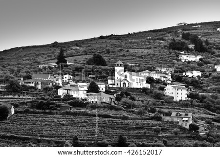 Village with Church Surrounded by Vineyards on the Hills of Portugal, Stylized Photo - stock photo