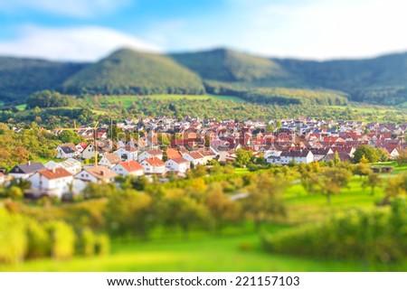 Village with tilt shift effect - Beuren, Swabian Alps, Germany - stock photo