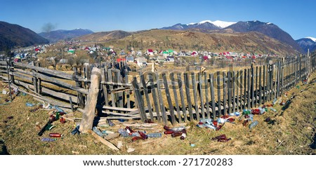 Villagers Transcarpathia throw trash in the same place and live on a background of mountains and pure nature - In Kolochava no special places for recycling.  a large cultural environmental issues. - stock photo