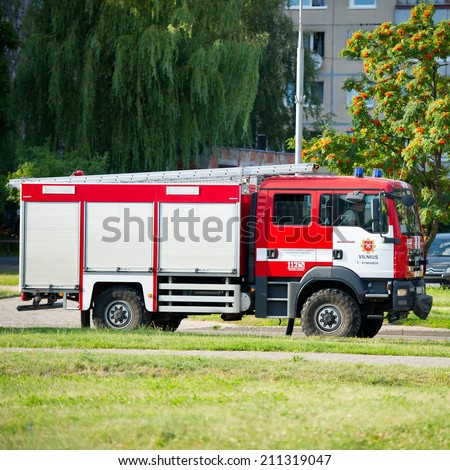 VILNIUS - JULY 25: Fire Truck MAN on July 25, 2014 in Vilnius, Lithuania. A firefighter (also known as a fireman) is a rescuer extensively trained in firefighting. - stock photo